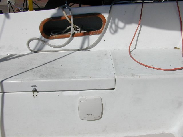 manual bilge pump installed in the port cockpit locker, forward section   it's a whale